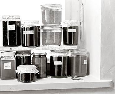 Various jam jars on a shelf, Food