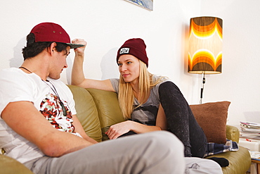Young couple talking on the sofa