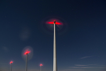 Wind turbines in the night sky, Rhade, Nordrhein-Westfalen, Germany
