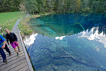 A man and a woman hiking at a small lake, Oberstdorf, Bavaria, Germany