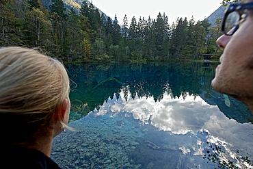 Couple at a lake, Oberstdorf, Bavaria, Germany