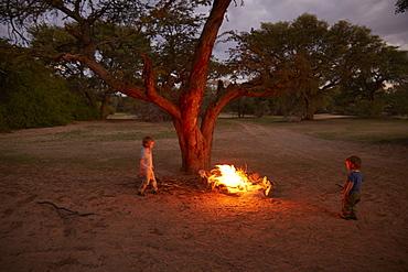 Two boys near a campfire, Hoarusib river, Namib desert, Nambia