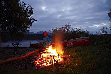 Boy at bonfire, lake Staffelsee, Seehausen, Upper Bavaria, Germany
