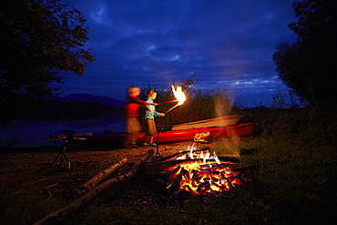 Children at bonfire, lake Staffelsee, Seehausen, Bavaria, Germany