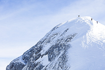 Backcountry skiers on Sonntagskogel peak, Tennengebirge mountains, Salzburg, Austria