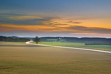 Evening sky in Puchheim overlooking the main road B2 towards Fuerstenfeldbruck, Puchheim, Bavaria, Germany