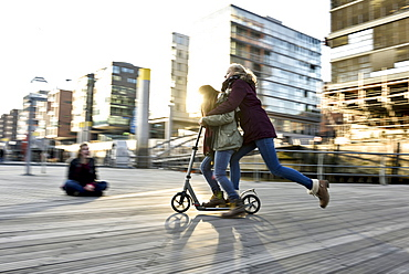 2 girls on a scooter in Hafencity, Hamburg, Germany, Europe - 1113-105004