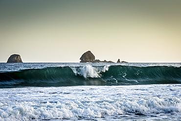 Long wave breaking on the coast of East Java, Java, Indonesia