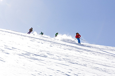 Group of people alpine skiing, powder skiing, avalanche assessment on a ski tour, risk management with groups, Vorderes Galmihorn, Obergoms, Berner Oberland, Switzerland
