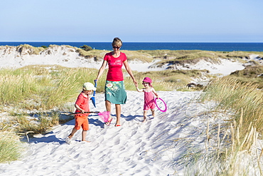 Young family, Mother and children hiking at the dream beach and dunes of Dueodde, sandy beach, Summer, Baltic sea, Bornholm, Dueodde, Denmark, Europe, MR
