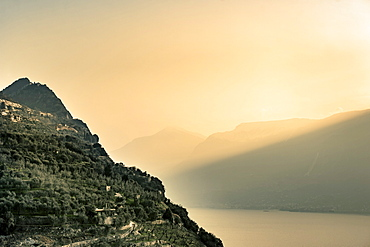 Sunrise in the mist, Tignale, Lake Garda, Alps, Lombardy, Italy