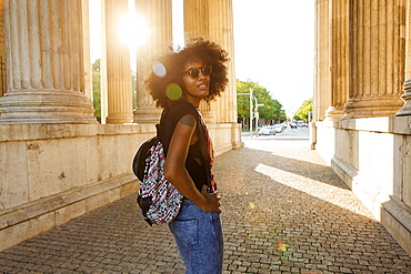 Young afro-american woman in backlight scenery at koenigsplatz, Munich, Bavaria, Germany