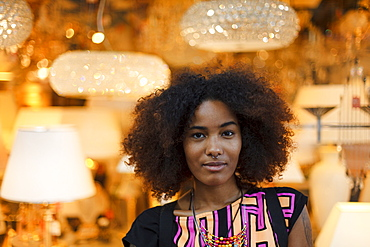 Portrait of a young afro-american woman in front of lamps, Munich, Bavaria, Germany
