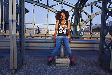 Graphic picture of young afro-american woman on a old steel bridge, Hackerbruecke Munich, Bavaria, Germany