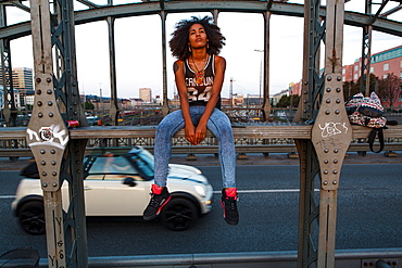 Graphic picture of young afro-american woman on a old steel bridge, Hackerbruecke, Munich, Bavaria, Germany