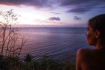 Young woman enjoying the view towards the sea at sunset, Sao Tome, Sao Tome and Principe, Africa