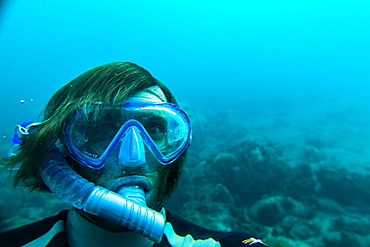 Young man snorkeling underwater, Sao Tome, Sao Tome and Principe, Africa
