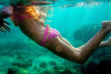 nine year old girl swimming with the mask, Cala s'Almunia, Mallorca, Balearic Islands, Spain