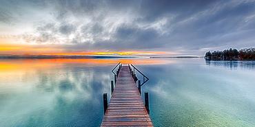 Jetty at sunrise on Lake Starnberg, Bavaria, Germany