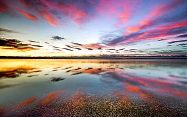 Sunrise with reflective clouds on Lake Starnberg, Bavaria, Germany