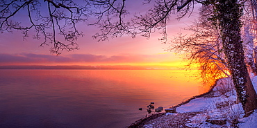 Winter morning with snow at sunrise on Lake Starnberg, Bernried, Bavaria, Germany