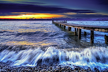 Sunset at Lake Starnberg in bad weather and waves, Bavaria, Germany