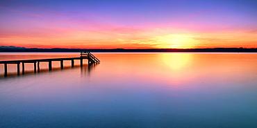 Jetty at sunset on Lake Starnberg, Bavaria, Germany