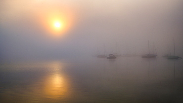 Boats in the harbor in foggy autumn mood, sunrise at Lake Starnberg, Seeshaupt, Bavaria, Germany