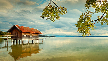 Boathouse at sunset on Ammersee, Bavaria, Germany