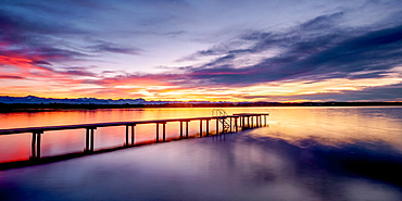 Jetty at sunset on Lake Starnberg, St. Heinrich, Bavaria, Germany
