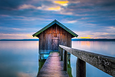 Boathouse at sunset on Ammersee, Stegen, Bavaria, Germany