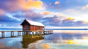 Snow-covered boat hut with jetty, Lake Starnberg, Tutzing, Bavaria, Germany
