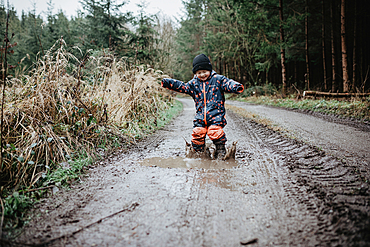 Toddler playing on muddy path in the forest, child, playing, forest