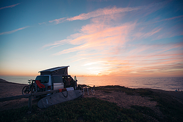 Camping bus stands at the seashore at sunrise, camping, vacation, Portugal