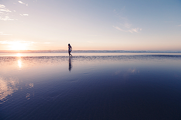 Woman walks on the beach in sunset, Portugal, beach, vacation