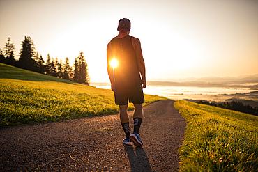 Runner enjoys the sunrise in the morning hours, running, sports, allg? U