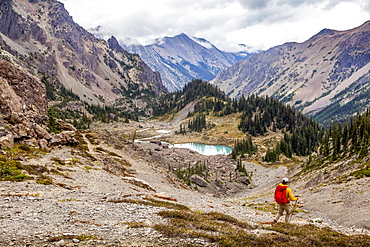 Male hiker in Royal Basin, Olympic Mountains, Olympic National Park, Washington, United States of America