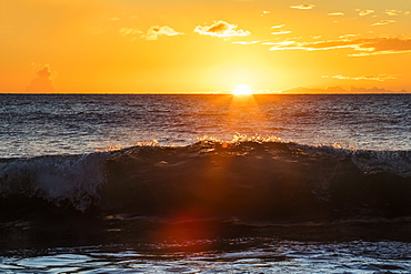 A golden sunset at Ulua Beach with wave, Wailea, Maui, Hawaii, United States of America
