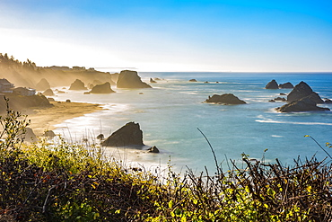 Morning mist rising from Harris Beach, near Brookings, Oregon. The rock formations add to the views looking out at the Pacific Ocean, Oregon, United States of America