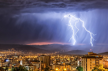 Stormy skies and lightning over a city at night, Cochabamba, Bolivia