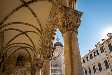 Detail of columns in the Rector's Palace facade and the Cathedral in the background, Dubrovnik, Dubrovnik-Neretva County, Croatia