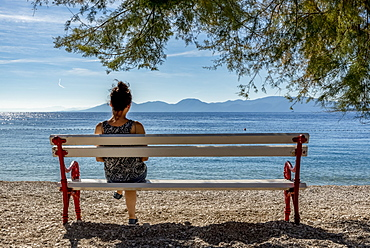 Woman enjoying the view of the Makarska Riviera, Dalmatia, Croatia