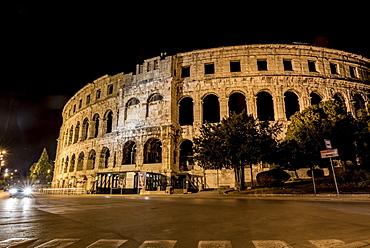 Ancient Roman Amphitheatre known as Pula Arena at night, Pula, Istria, Croatia