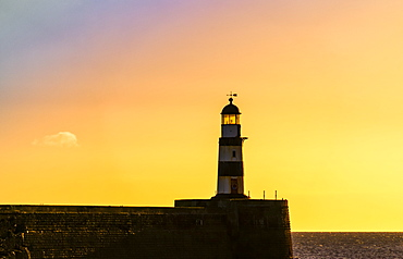 Lighthouse with golden sky at sunset, Seaham, Durham, England