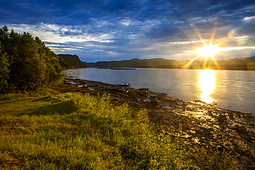 Sun going down on the Yukon River in summer, Alaska, United States of America
