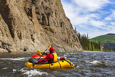 Two women packrafters negotiating a tributary of the Charley River in summertime, Yukon–Charley Rivers National Preserve, Alaska, United States of America