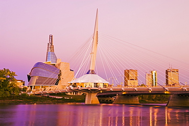 Winnipeg skyline from St. Boniface showing the Red River, Esplanade Riel Bridge and Canadian Museum for Human Rights, Winnipeg, Manitoba, Canada