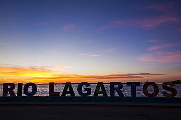 City sign at sunset, Rio Lagartos, Yucatan, Mexico
