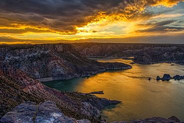 Fiery sunset clouds on a desert lake, San Rafael, Mendoza, Argentina
