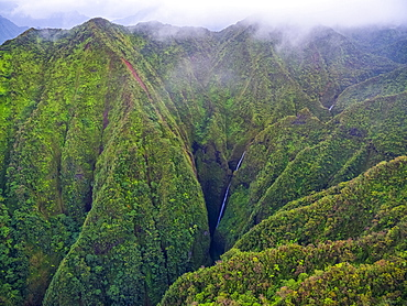 Aerial image of the lush mountains surrounding Oahu, Oahu, Hawaii, United States of America